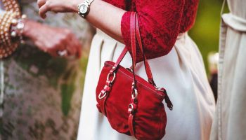 woman-in-red-blouse-and-with-red-handbag